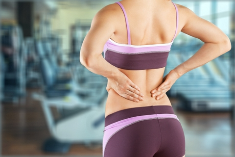 Woman pain muscle injury
